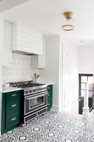 Dark green and white painted cabinets.