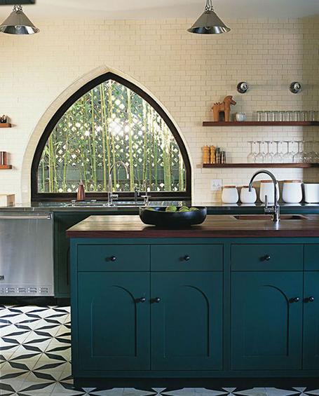 Dark blue painted kitchen cabinets.