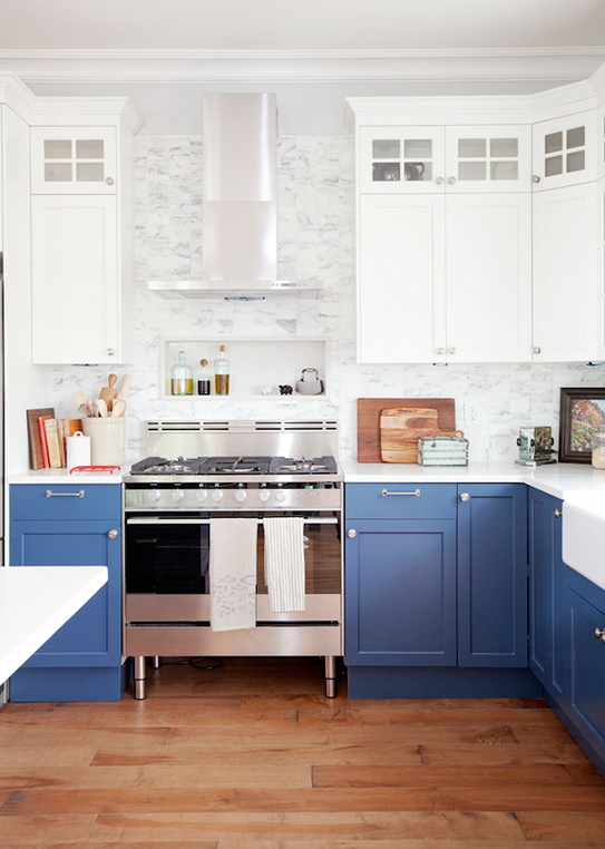 Blue and white painted kitchen cabinets.