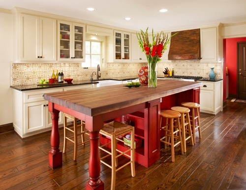 Warm color painted kitchen cabinets.