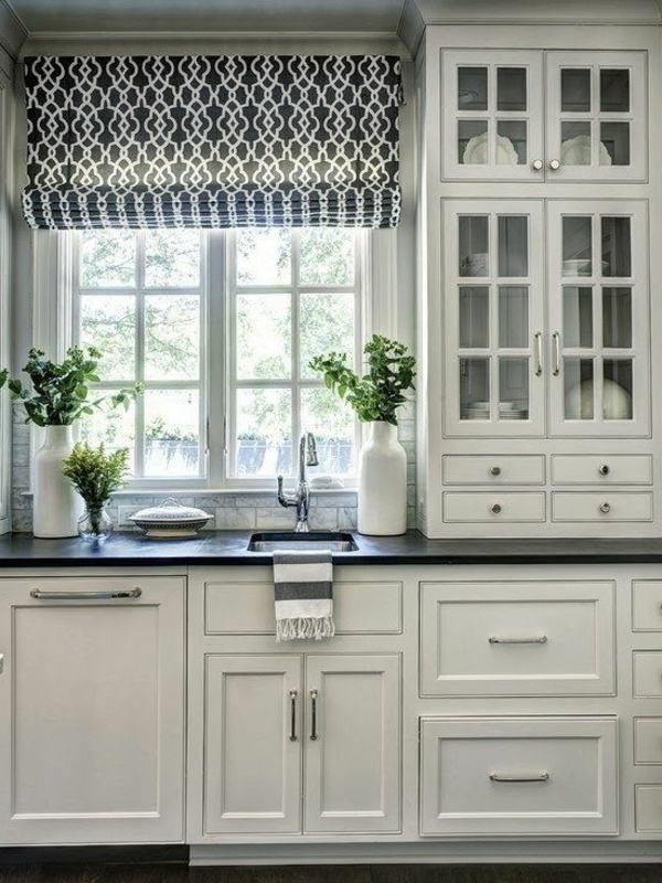White kitchen cabinets with black countertop.