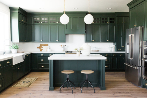 Forest green painted kitchen cabinets.