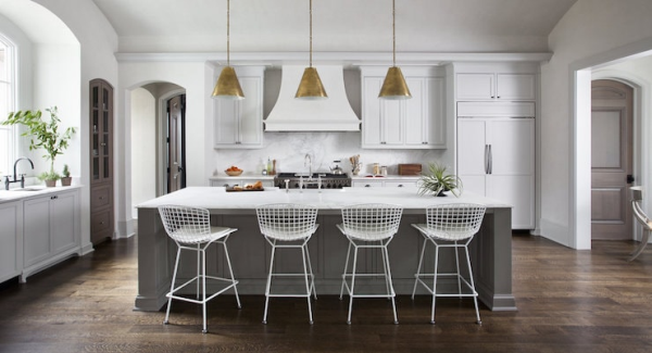 Bright kitchen with white cabinets and island.