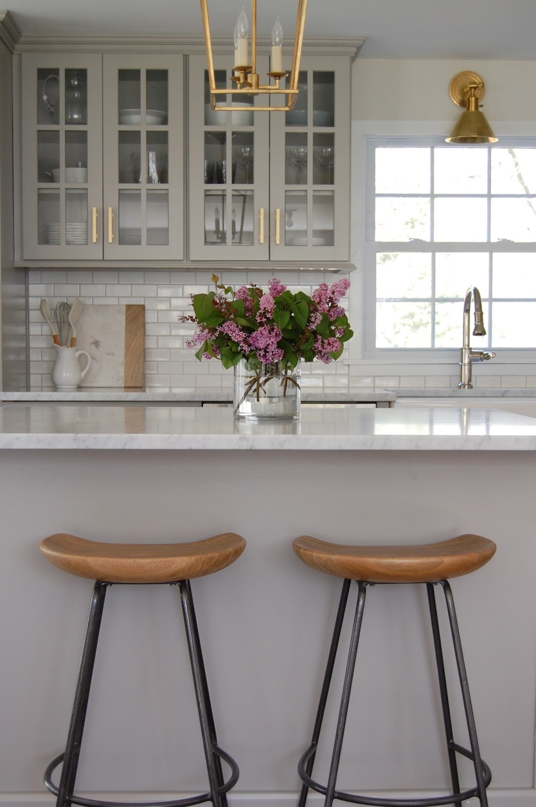 Gray glass-front kitchen cabinets.