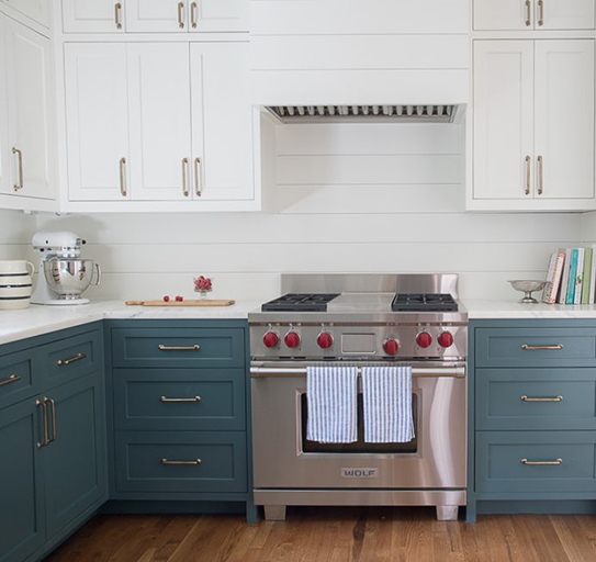 Blue lower cabinets & white top cabinets.