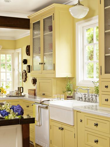 Yellow glass-front kitchen cabinets.
